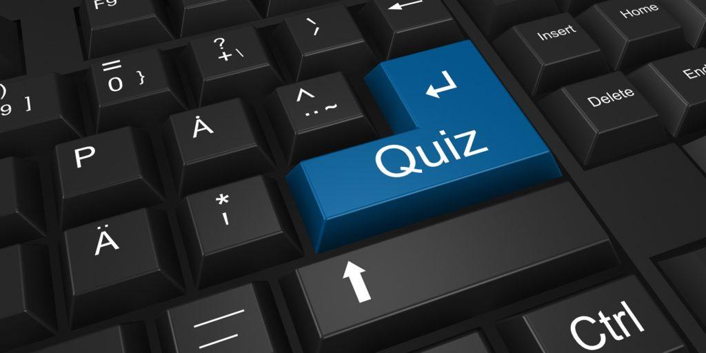 """Tastatur mit dem Vermek """"Quiz"""" auf der Enter-Taste"""